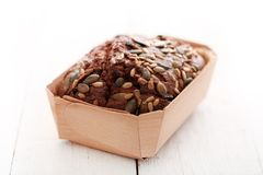 Homemade bread with grains in a box Stock Image