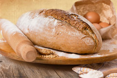 Homemade bread and ingredients Stock Images