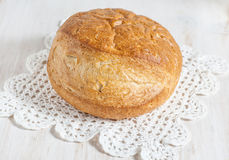 Homemade bread on the lace napkin Royalty Free Stock Images