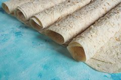 Homemade bread lavash bread on blue background. stock images