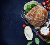 Homemade bread loaf and vegetables Royalty Free Stock Image
