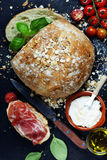 Homemade bread loaf and vegetables Stock Photo