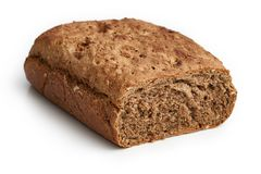 Homemade bread made with whole-wheat flour. Whole rye flour, buckwheat and hemp flour, sunflower seeds, fennel seeds and walnuts isolated on white background stock images