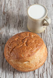 Homemade bread and milk on the wooden board Royalty Free Stock Photography
