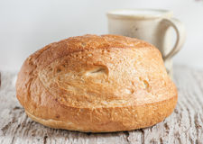 Homemade bread and milk on the wooden board Royalty Free Stock Photo
