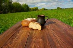 Homemade bread and mug milk Royalty Free Stock Photos