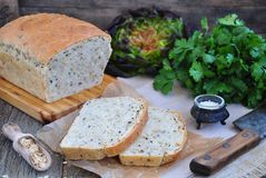 Homemade bread with oat flakes, linseed and black sesame seeds Royalty Free Stock Photo