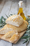 Homemade bread with olive oil. Italic traditional berad chiabatta with bottle of olibe oil and olive branch Stock Images