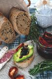 Homemade bread with olives with sun-dried tomatoes, avocado and olive oil Stock Photography