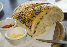 Homemade bread, ramekin with butter and spicy spread Royalty Free Stock Images