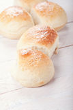 Homemade bread rolls. Fresh homemade bread rolls with sesam seed on table Royalty Free Stock Photo