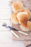 Homemade bread rolls. Fresh homemade bread rolls with sesam seed on table Stock Images