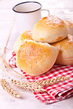Homemade bread rolls. Fresh homemade bread rolls with sesam seed on table Royalty Free Stock Images