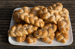 Homemade bread rolls on a plate. On wooden terrace Royalty Free Stock Photography