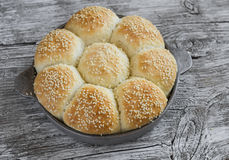 Homemade bread rolls in a vintage pan. On wooden background Royalty Free Stock Photo