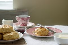 Homemade bread scones with hot tea, traditional British pastries. Selective focus Stock Photography