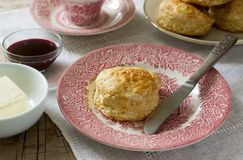 Homemade bread scones with hot tea, traditional British pastries. Selective focus Royalty Free Stock Photo