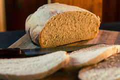 Homemade Bread 2. Second shot of homemade, slowcooker bread with cut side of loaf in focus Royalty Free Stock Photography