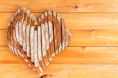 Homemade bread shaped as heart on picnic table Royalty Free Stock Photo