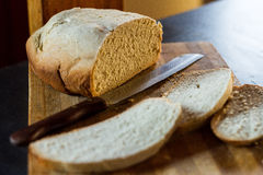 Homemade Bread 1. Homemade bread shot with slices and the knife in frame. Focus is on loaf Stock Photos