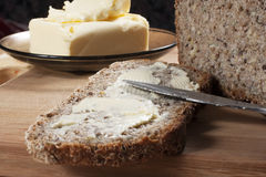 Homemade bread. Homemade slice of bread with butter Stock Images