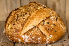 Homemade bread with sunflower seeds. Freshly baked. Stock Photos