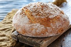 Whole homemade bread with sunflower seeds. Royalty Free Stock Photo