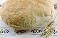 Homemade bread on a vintage tablecloth Royalty Free Stock Image