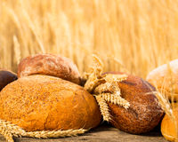 Homemade bread and wheat on the wooden table Royalty Free Stock Photography