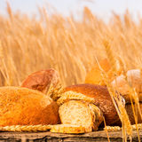 Homemade bread and wheat on the wooden table Stock Photo