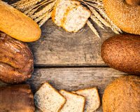 Homemade bread and wheat on the wooden table Royalty Free Stock Photos