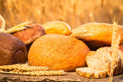 Homemade bread and wheat on the wooden table Royalty Free Stock Images