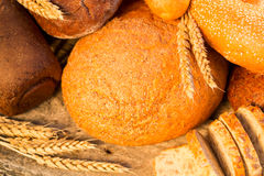 Homemade bread and wheat on the wooden table Royalty Free Stock Image