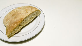 Homemade bread. In a white plate Stock Photos