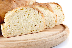 Homemade bread on wooden breadboard Stock Photo
