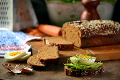 Homemade bread on a wooden cutting board Royalty Free Stock Photos