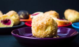 Homemade breadcrumb dumplings on colorful plates. Close up Stock Photos