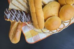 Homemade breads on the table. Top view of homemade breads on the basket above wooden table Stock Photos