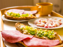 Homemade breakfast: bread with ham, onions, radish. And tea, prepared for a couple, detail Royalty Free Stock Images