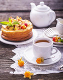 Homemade breakfast. Fresh cheesecake with berries ripe northern rare cloudberries on a wooden background  vintage Royalty Free Stock Image