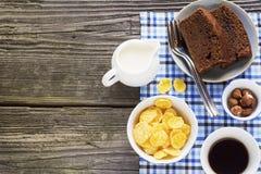 Homemade breakfast option.  chocolate cake, cereals, nuts, hazelnuts, milk Royalty Free Stock Photo