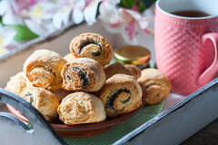 Homemade breakfast: rolls and cup of tea on vintage serving tray. Stock Images