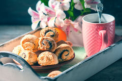 Homemade breakfast: rolls and cup of tea on vintage serving tray. Stock Image