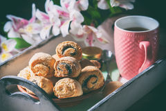 Homemade breakfast: rolls and cup of tea on vintage serving tray. Stock Photo