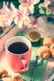 Homemade breakfast: rolls and cup of tea on vintage serving tray. Royalty Free Stock Photos