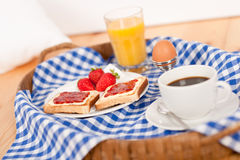 Homemade breakfast on wicker tray Royalty Free Stock Images