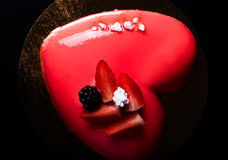 Homemade bright mousse cake with mirror glaze. Selective focus Stock Photo