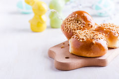 Homemade brioche buns on Easter table Royalty Free Stock Photography