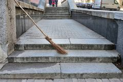 Homemade broom on the street along the trouter. City cleaning royalty free stock image
