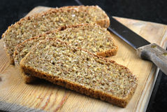 Homemade brown bread. On cutting board Royalty Free Stock Image